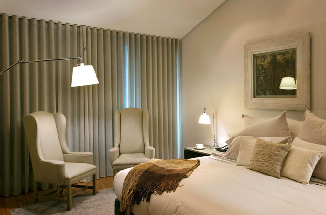 silent gliss wave curtains in a hotel bedoroom